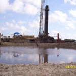 Reflection-of-Rig-in-Water-Pit